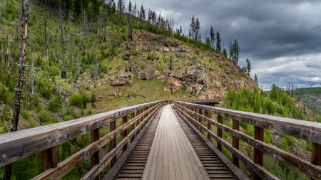 Biking over the Wooden Trestle Bridges of the abandoned Kettle Valley Railway in Myra Canyon near Kelowna, British Columbia, Canada