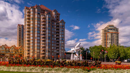 Kelowna, British Columbia/Canada - July 24, 2020: Gardens and High Rise Buildings around the Rhapsody Plaza in the city of Kelowna