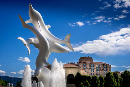 Kelowna, British Columbia/Canada - July 24, 2020: Rhapsody, a group of Fiberglass Dolphins, in a Fountain at Rhapsody Plaza in the city of Kelowna