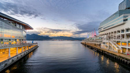 Vancouver, BC/Canada - July 16, 2020: Sunset over the Vancouver Harbour between the Seaplane Terminal and the Canada Place Cruise Terminal in Downtown Vancouver