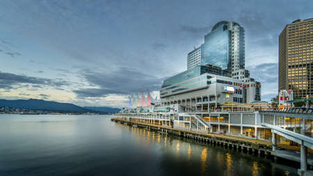 Vancouver, BC/Canada - July 16, 2020: Blue Hour at the Canada Place Cruise Terminal Building after the sun has set over the Horizon of Vancouver Harbour