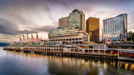 Vancouver, BC/Canada - July 16, 2020: Golden Hour Sunset over the Canada Place Cruise Terminal Building and High Rise Buildings of Downtown Vancouver