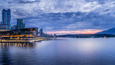 Vancouver, BC/Canada - July 16, 2020: Sunset over the Seaplane Terminal and the High Rise Condominium Towers in the Coal Harbour Neighbourhood on the shore of Vancouver Harbor