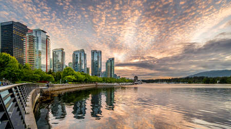Vancouver, BC/Canada - July 16, 2020: Sunset over the High Rise Condominium Towers in the Coal Harbour Neighbourhood on the shores of Vancouver Harbor