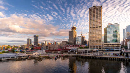 Vancouver, BC/Canada - July 16, 2020: Sunset over Downtown Vancouver and the Waterfront Seabus Terminal Editoriali