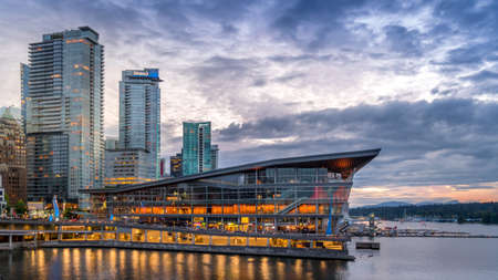 Vancouver, BC/Canada - July 16, 2020: The Seaplane Terminal and High Rise Condominium Towers in the Coal Harbour Neighbourhood of Vancouver after the Sun has set over the Horizon of Vancouver Harbor