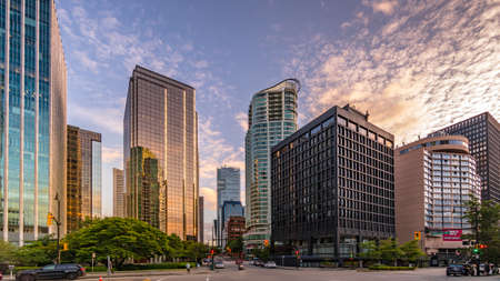 Vancouver, BC/Canada - July 16, 2020: Sunset over the High Rise Buildings in the Coal Harbour Neighbourhood of Vancouver at the intersection of Thurlow Street and Cordova Street Editoriali