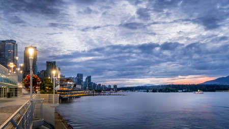 Vancouver, BC/Canada - July 16, 2020: Blue Hour at the Canada Place Cruise Terminal Promenade after the sun has set over the Horizon of Vancouver Harbour