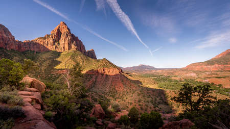 Sunrise over The Watchman Peak and the Virgin River Valley in Zion National Park in Utah, USA, during an early morning hike on the Watchman hiking trail