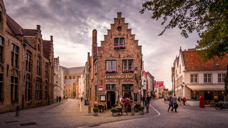 Brugge/Belgium - Sept. 18 2018: Historic Brick Houses at the corner of Mariastraat and Heilige-Geeststraat in the heart of the medieval city of Bruges, Belgium