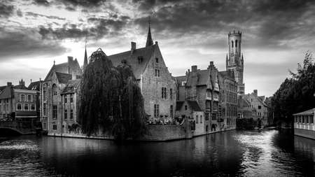 Brugge/Belgium - Sept. 18 2018: Black and White Photo of Historic buildings and the Belfort Tower viewed from the Dijver Canal in the medieval city of Bruges, Belgium