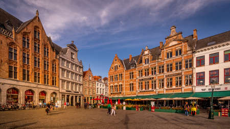 Brugge / Belgium - Sept. 18, 2018: Colorful Medieval houses with Step Gables lining the central Markt (Market Square) in the heart of Bruges, Belgium Editoriali