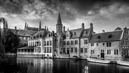 Black and White Photo of the Historic buildings and the tower of the Huidenvettershuis at the Dijver Canal in the medieval city of Bruges, Belgium