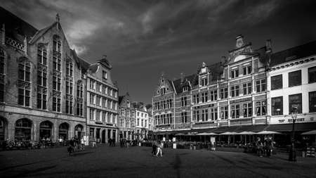Brugge / Belgium - Sept. 18, 2018: Black and White Photo of Medieval houses with Step Gables lining the central Markt (Market Square) in the heart of Bruges, Belgium