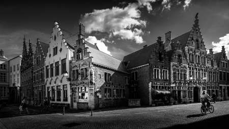 Brugge / Belgium - Sept. 18, 2018: Black and White Photo of Medieval houses with step gables along the cobblestone streets of the historic city of Bruges, Belgium Editoriali