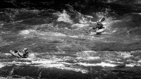Spences Bridge, BC/Canada-Feb. 14, 2015: Black and White Photo of White Water Kayaking in the Rapids of the Thompson River near Spences Bridge in British Columbia, Canada Editöryel