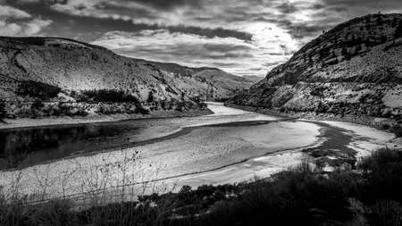 Black and White Photo of Sunset over the Winter Landscape of the semi arid Thompson River Valley and the Trans Canada Highway in central British Columbia, Canada
