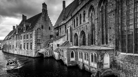 Brugge/Belgium - Sept. 19 2018: Black and White photo of the 12th Century historic Saint John's Hospital in the Medieval City of Bruges viewed from the adjoining Canal Editöryel
