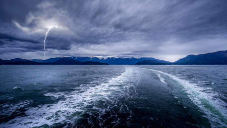 Dark Clouds and Lightning Strike in the Wake of a Ferry between Horseshoe Bay and Sechelt in British Columbia, Canada
