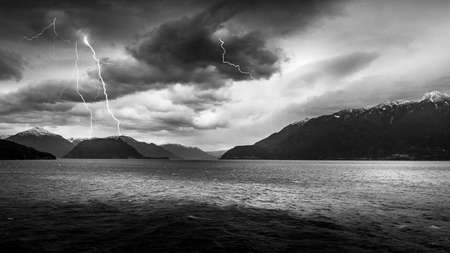 Black and White Photo of Dark Clouds and Lightning Strikes in the during a Ferry ride between Horseshoe Bay and Sechelt in British Columbia, Canada