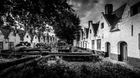 Black and White Photo of the 'Princely Beguinage Ten Wijngaarde' with its white-coloured house fronts and tranquil convent garden founded in 1245