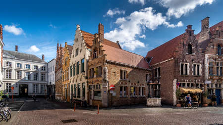 Brugge / Belgium - Sept. 18, 2018: Medieval houses with step gables along the cobblestone streets of the historic city of Bruges, Belgium Editöryel