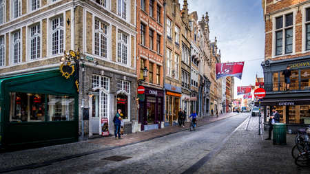 Bruges/Belgium-Sept 19, 2018: Early Morning activity on the normally busy Steenstraat in the historic city of Brugge in Belgium Editöryel