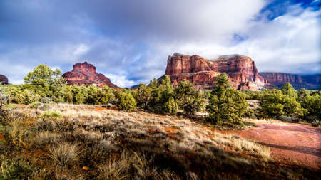 The red rock sandstone mountains of Bell Rock, Munds Mountain and Courthouse Butte near Sedona in Northern Arizona in Coconino National Forest in the United States Фото со стока