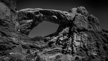 Black and White Photo of the South Window Arch, one of the many large Sandstone Arches in Arches National Park, Utah, United States