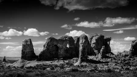 Black and White Photo of the Unique Red Sandstone Formations of the Parade of Elephants in Arches National Park near the town of Moab in Utah, USA