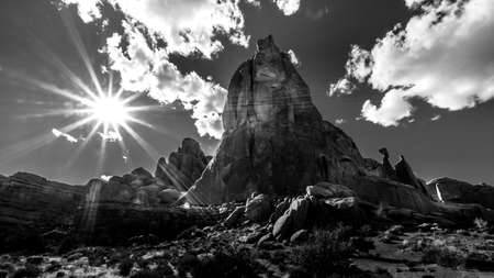 Black and White Photo of the Sun setting over the Sandstone Formations along the Arches Scenic Drive in Arches National Park near Moab, Utah, USA