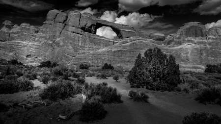 Black and White Photo of Skyline Arch in the Devil's Garden, one of the many sandstone arches in Arches National Park near Moab, Utah, United States