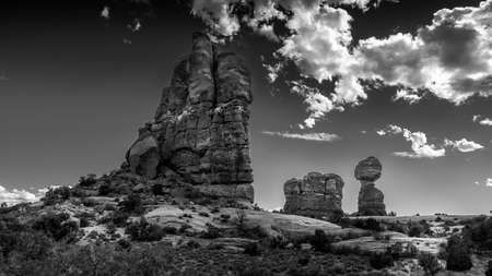 Black and White Photo of Balanced Rock and other Sandstone Formations along the Arches Scenic Drive in Arches National Park near Moab, Utah, USA Фото со стока