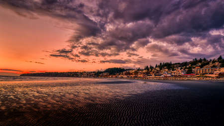 Sun Setting over Semiahmoo Bay and the village of White Rock in British Columbia, Canada