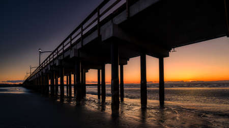 Sun Setting over Canada's Longest Pier in Semiahmoo Bay at the village of White Rock in British Columbia, Canada
