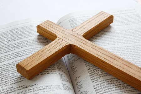 Open bible with wooden cross photo