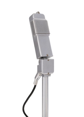 Front view of a vintage cardioid microphone on white background