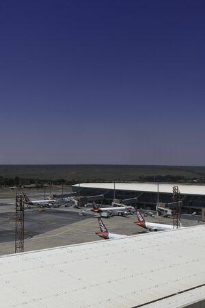 LATAM airplanes on the tarmac at Brasilia's International Airport.