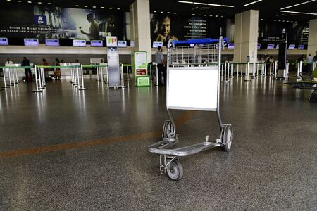 Empty airport trolley with blank advertising space.