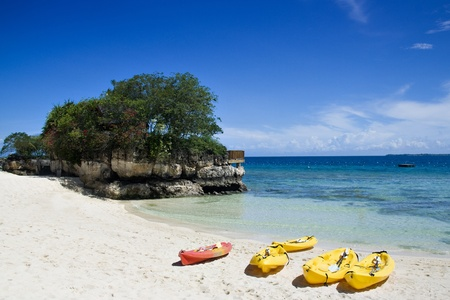 Kayaks in sunny tropical beach