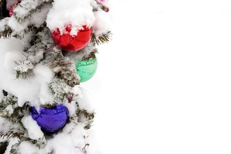 Outdoor Christmas decorations covered in snow