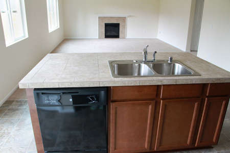Empty kitchen and living room area in a new house.