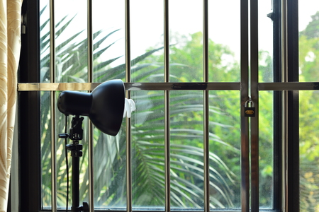 curtain background: Photographic equipment at window side