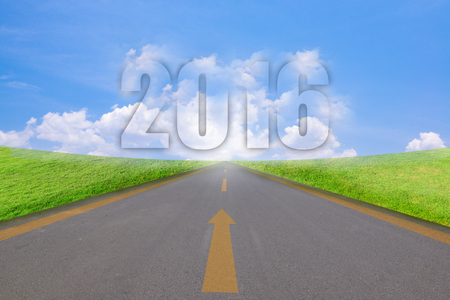 expected: 2016 year shape clouds in the blue sky, with running track and grass.