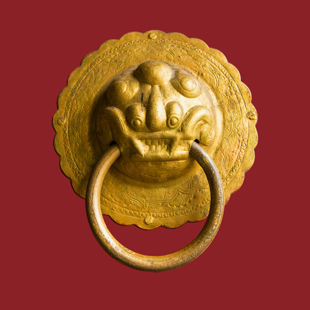 bronzy: Close up of an isolated lion-shaped door knocker Stock Photo