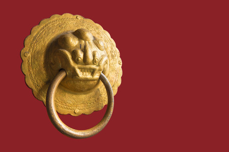 bronzy: Lion knocker on the chinese traditional red door Stock Photo