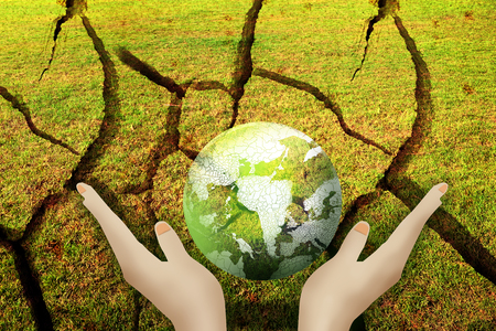 suggest: Hands holding the green earth on dry land to suggest save water, save earth, save environment. Stock Photo