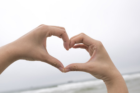 female form: Female hands in the form of heart