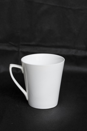cofe: Cup over black background