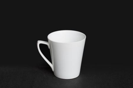 over black: Cup over black background